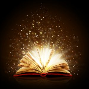 Text book laying open with magic dust flying out of the book