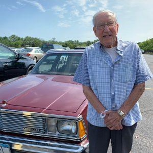70-year GRAR Member Gene Cassata standing next to his 1981 Chevy Malibu Classic